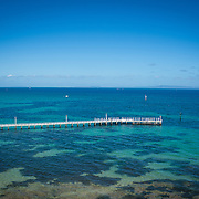Long Pier with clear water and blue sky