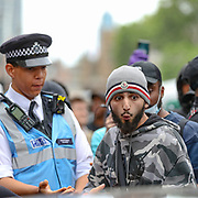 Protesters interact with police officers near Downing Street in London, Wednesday, June 3, 2020 during a demonstration over the death of George Floyd, a black man who died after being restrained by Minneapolis police officers on May 25. Protests have taken place across America and internationally, after a white Minneapolis police officer pressed his knee against Floyd's neck while the handcuffed black man called out that he couldn't breathe. The officer, Derek Chauvin, has been fired and charged with murder.  (Photo/ Vudi Xhymshiti)