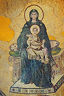 Byzantine mosaic of the Virgin and Child was the first of the post-iconoclastic mosaics inaugurated on 29 March 867 by Patriarch Photius and the emperors Michael III and Basil I.  Hagia Sophia, Istanbul, Turkey .<br /> <br /> If you prefer to buy from our ALAMY PHOTO LIBRARY  Collection visit : https://www.alamy.com/portfolio/paul-williams-funkystock/hagia-sophia-istanbul.html<br /> <br /> Visit our TURKEY PHOTO COLLECTIONS for more photos to download or buy as wall art prints https://funkystock.photoshelter.com/gallery-collection/3f-Pictures-of-Turkey-Turkey-Photos-Images-Fotos/C0000U.hJWkZxAbg