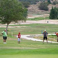 072313        Brian Leddy<br /> Tim Pino, Bill Armstrong and Ezra Pino watches as Seth Pino hits a ball toward the green at Fox Run Golf Course Tuesday July 23.