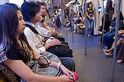 01 MARCH 2008 -- BANGKOK, THAILAND:  Riders on the BTS, the elevated train in Bangkok, Thailand.   Photo by Jack Kurtz/ZUMA Press