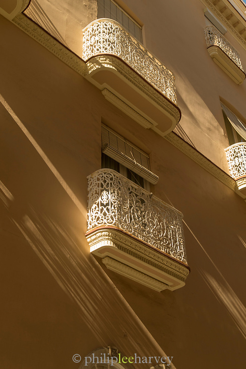 Low angle view of building exterior with balconies, Cadiz, Andalusia, Spain