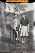 fading image husband and wife in countryside 1950s out of focus