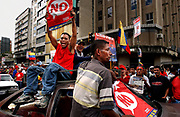 Chavistas celebrate in the streets outside Miraflores Palace the morning after Venezuela's President Hugo Chavez received enough votes in a presidential recall referendum to remain in office, Monday, August 16, 2004.  Photographer: Emile Wamsteker/World Picture News