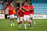 Jerry Yates of Swindon Town celebrates with Keshi Anderson of Swindon Town as he scores to make it 0-2 during the EFL Sky Bet League 2 match between Scunthorpe United and Swindon Town at Sands Venue Stadium, Glanford Park, Scunthorpe, England on 3 August 2019.