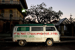 21 December 05. New Orleans, Louisiana Post Katrina aftermath.<br /> A VW camper van showing flood levels waits to be towed from Leda Street in Mid City. <br /> Photo; ©Charlie Varley/varleypix.com