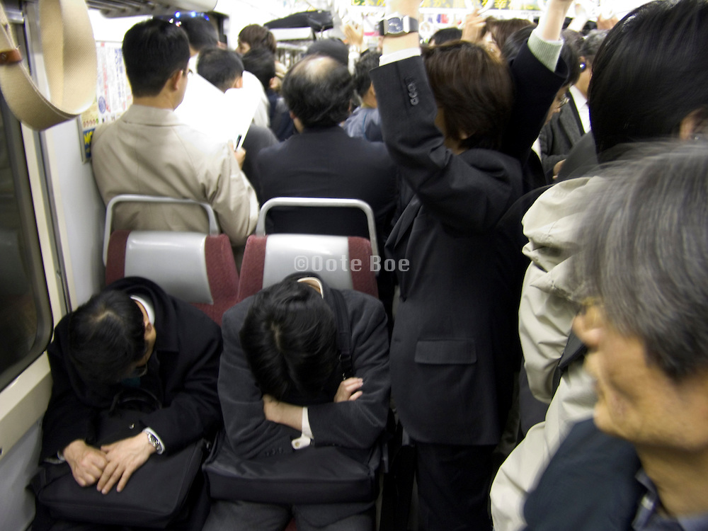 commuters on a train during rush hour Tokyo Japan