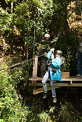 Chile, Lake Country: Adventure canopy ride on a zip line through the rain forest at Peulla..Photo #: ch617-33304..Photo copyright Lee Foster www.fostertravel.com, lee@fostertravel.com, 510-549-2202.