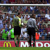 Photo: Richard Lane.<br />Arsenal v Manchester United. The FA Charity Shield 2003. 10/08/2003.<br />The goalkeepers, Jens Lehmann and Tim Howard head to the goal for the penalty shootout.
