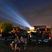 Family members watch a movie at the Moonlite Drive-in in Woodbury, Tennessee. The drive-in shows movies every Friday, Saturday and Sunday in the summer months. Nathan Lambrecht/Journal Communications