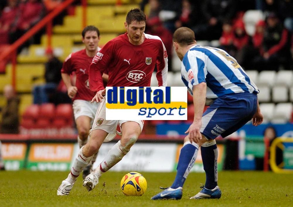 Photo: Leigh Quinnell.<br /> Bristol City v Huddersfield Town. Coca Cola League 1. 10/02/2007. Bristol Citys Phil Jevons looks to pass Huddersfields David Mirfin.