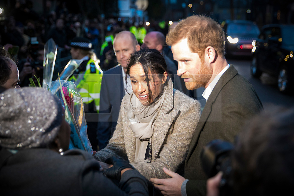 © Licensed to London News Pictures. 09/01/2018. Prince Harry and Meghan Markle meet members of the public during a visit to Reprezent Radio in Pop Brixton, South London. The radio station was established in 2008 as a response to increased knife crime in order to help young people develop skills through radio. Photo credit: Rob Pinney/LNP
