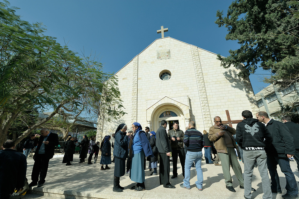 Catholics gather in front of the Holy Family Catholic Church in Gaza City, following Sunday Mass. There are only some 3,000 Christians in Gaza, of which just 200 are Catholic..