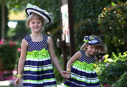 Lucille (8) and Beatrice (4) de Kuiper pose for photographers during day four of Royal Ascot at Ascot Racecourse. PRESS ASSOCIATION Photo. Picture date: Friday June 22, 2018. See PA story RACING Ascot. Photo credit should read: Steve Parsons/PA Wire. RESTRICTIONS: Use subject to restrictions. Editorial use only, no commercial or promotional use. No private sales.