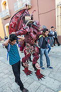 Man dressed in an American style devil costume during the Day of the Dead Festival known in spanish as Día de Muertos on October 25, 2014 in Oaxaca, Mexico.