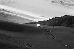 Man and super jeep at the volcanic eruption at Fimmvorduhals in Eyjafjallajokull, Iceland - eldgos og fólk á Fimmvörðuhálsi