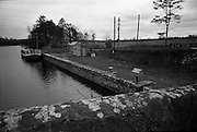 06-10/04/1964.04/06-10/1964.06-10 April 1964.Views on the River Shannon. The pretty quay at Jamestown bridge is always a stopping place for the travelling photographer on the Shannon trail. The quay provides ideal anchorage for pleasure craft and houseboats. A new jetty for shorter cruisers will soon e built on the opposite bank of the river, Drumsna Co. Leitrim.