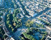Nederland, Amsterdam, Weteringcircuit, 17-10-2005; luchtfoto (25% toeslag); onder: brug over de Singelgracht (Stadhouderskade); links van het circuit: Eerste Weteringplantsoen, rechts H.M.van Randwijkplantsoen; diagonaal vanuit het midden (naar rechtboven): Vijzelgracht met  werkzaamheden aan de Noord-Zuidlijn; stadsbomen, stadsgroen, centrum, grachtengordel ..zie ook andere (lucht)foto's van deze locatie.<br /> Foto Siebe Swart