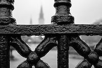 Close up of iron fence around Jackson Square in New Orleans with the St. Louis Cathedral behind.