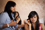 Micha Patel, 16 from Fortismere School, and her Friend Ayse  get ready for their school Prom in Muswell Hill with the help of Aunt Pretty. In recent years American style prom nights to celebrate graduation from high School have been gaining popularity in the UK. These pictures are part of a set  commissioned for the Times magazine that  look at this teenage rite of passage across three schools in the UK.