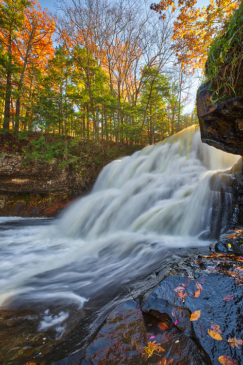 New England fall foliage framing Wadsworth Falls and Conginchaug River at Wadsworth Falls State Park in Middletown, Connecticut. Indian Well State Park is only a 25 minute drive from New Haven and rewards with this spectacular New England waterfall. <br /> <br /> Connecticut waterfall of Indian Well Falls photography images are available as museum quality photography prints, canvas prints, acrylic prints or metal prints. Prints may be framed and matted to the individual liking and decorating needs at:<br /> <br /> https://juergen-roth.pixels.com/featured/wadsworth-falls-juergen-roth.html<br /> <br /> All high resolution Connecticut photography images are available for photo image licensing at www.RothGalleries.com. Please contact me direct with any questions or request. <br /> <br /> Good light and happy photo making!<br /> <br /> My best,<br /> <br /> Juergen<br /> Prints: http://www.rothgalleries.com<br /> Photo Blog: http://whereintheworldisjuergen.blogspot.com<br /> Instagram: https://www.instagram.com/rothgalleries<br /> Twitter: https://twitter.com/naturefineart<br /> Facebook: https://www.facebook.com/naturefineart