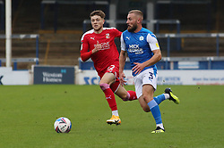 Dan Butler of Peterborough United in action against Jordan Stevens of Swindon Town - Mandatory by-line: Joe Dent/JMP - 03/10/2020 - FOOTBALL - Weston Homes Stadium - Peterborough, England - Peterborough United v Swindon Town - Sky Bet League One