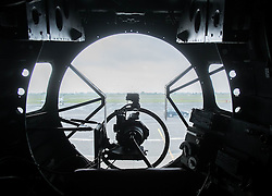 © Licensed to London News Pictures. <br /> 28/08/2014. <br /> <br /> Durham Tees Valley Airport, United Kingdom<br /> <br /> The view from the front gunners seat as one of only two remaining flying Avro Lancaster bombers visits Durham Tees Valley airport today. <br /> <br /> The aircraft, 'Mynarski' is named after Pilot Officer Andrew Mynarski who flew with the Canadian Royal Air Force from the airport which was then called RAF Middleton St George.<br /> <br /> Pilot Officer Mynarski was posthumously awarded a VC after giving his life while trying to save a colleague when their Lancaster was shot down in June 1944.<br /> <br /> The famous World War Two aircraft is owned by the Canadian Warplane Heritage Museum and is beginning a 2-week tour of the UK.<br /> <br /> Photo credit : Ian Forsyth/LNP
