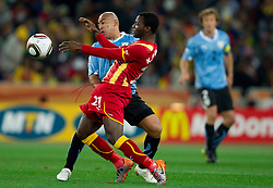 Egidio Arevalo of Uruguay vs Kwadwo Asamoah of Ghana  during to the 2010 FIFA World Cup South Africa Quarter Finals football match between Uruguay and Ghana on July 02, 2010 at Soccer City Stadium in Sowetto, suburb of Johannesburg. (Photo by Vid Ponikvar / Sportida)