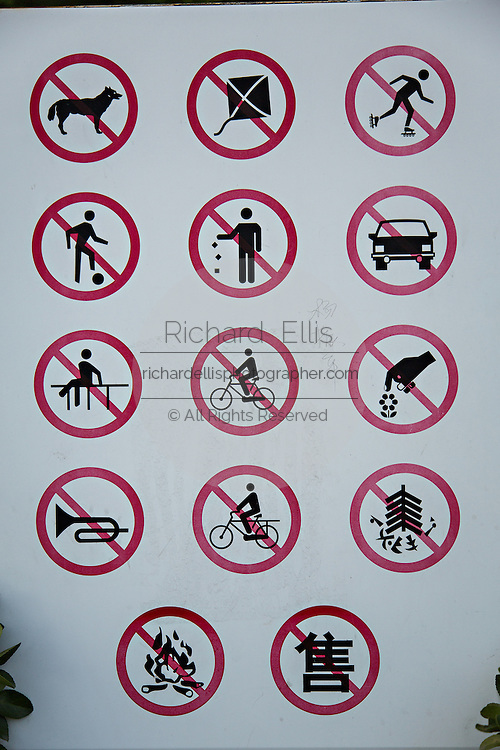 Sign banning a variety of activities in a park in Beijing, China
