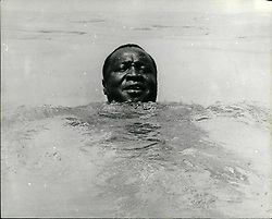Dec. 12, 1965 - Amin Keeps In The Swim: It's difficult to keep President Amin of Uganda out of the news, even when he has no official duties, and when he fancies a swim he makes shore their are photographers around to keep him in the news. Photo shows head of Idi Amin in water Jaws Is The Warmest, Tenderest, Lovingest Movie Of They Year. I Give It Four Coconuts. (Credit Image: © Keystone Pictures USA/ZUMAPRESS.com)