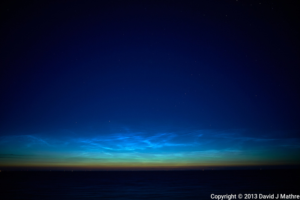 Noctilucent Clouds Over the Baltic Sea. From my cabin on the MV Explorer while traveling from Stockholm to Copenhagen. Image taken with a Nikon D4 camera and 28 mm f/1.8 lens (ISO 200, 28 mm, f/1.8, 1 sec). Raw image processed with Capture One Pro.