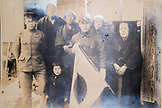 family group posing with son's in military uniform and Japanse flag ca 1930s