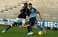 Photo: Paul Greenwood.<br />Port Vale v Swansea City. Coca Cola League 1. 18/11/2006. Swansea's Kevin Amankwaah battles with Vales Jason Talbot
