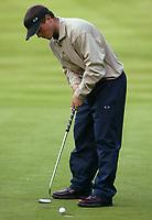 Photograph: Scott Heavey<br />Volvo PGA Championship At Wentworth Club. 23/05/2003.<br />Henrik Bjørnstad putts in at the 12th.