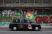 "The face of Saudi Crown Prince Mohammed bin Salman on the side of two black cabs in Shoreditch, 7th March 2018, in east London England. Industry sources said the Saudis could be spending close to £1m on the campaign, which includes dozens of prime poster sites around London and newspaper ads. ""He is bringing change to Saudi Arabia,"" the ads say, with a large photo of Crown Prince Mohammed bin Salman and the hashtag #ANewSaudiArabia."
