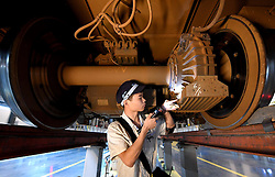 ZHENGZHOU, Sept. 7, 2016 (Xinhua) -- A mechanic checks a CRH high-speed train at a maintenance center in Zhengzhou, capital of central China's Henan Province, Sept. 6, 2016. (Xinhua/Li An) (wf) (Credit Image: © Li An/Xinhua via ZUMA Wire)