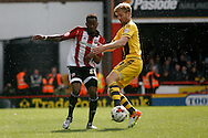 James Ferry of Brentford being challenged by Tim Ream of Fulham. Skybet football league championship match, Brentford  v Fulham at Griffin Park in London on Saturday 30th April 2016.<br /> pic by Steffan Bowen, Andrew Orchard sports photography.