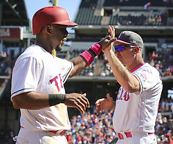 May 14, 2017 - Arlington, TX, USA - Texas Rangers shortstop Elvis Andrus (1) high fives Texas Rangers manager Jeff Banister (28) after scoring the go-ahead run against the Oakland Athletics in the seventh inning on Sunday, May 14, 2017 at Globe Life Park in Arlington, Texas. (Credit Image: © Richard W. Rodriguez/TNS via ZUMA Wire)