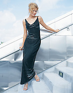 Editorial image of a pretty model wearing a metalic evening dress, created for a local retailer of high end dresses.