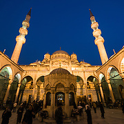 The courtyard of the New Mosque (Yeni Cami) in Istanbul. Situated in the busy Eminonu quarter of Istanbul, at the southern end of the Galata Bridge, the New Mosque (or Yeni Cami) dates to around 1665. It's large prayer hall is decorated in the distinctive Ottoman imperial style.