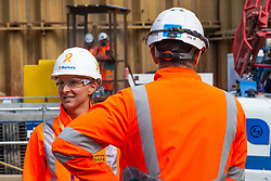 GRAPHITE: Workers at the Barhale Thames Tideway Victoria Embankment site wear the suicide awareness stickers on their hard hats. London, September 05 2019.