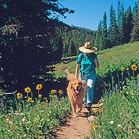Meredith Wiltsie and Khangri hike on Beehive Basin Trail, near Big Sky, Montana.