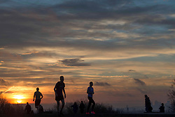© Licensed to London News Pictures.23/02/2021. London, UK. Members of the public exercise during sunrise at Hampstead Heath, North London while the third national lockdown continues. Photo credit: Marcin Nowak/LNP
