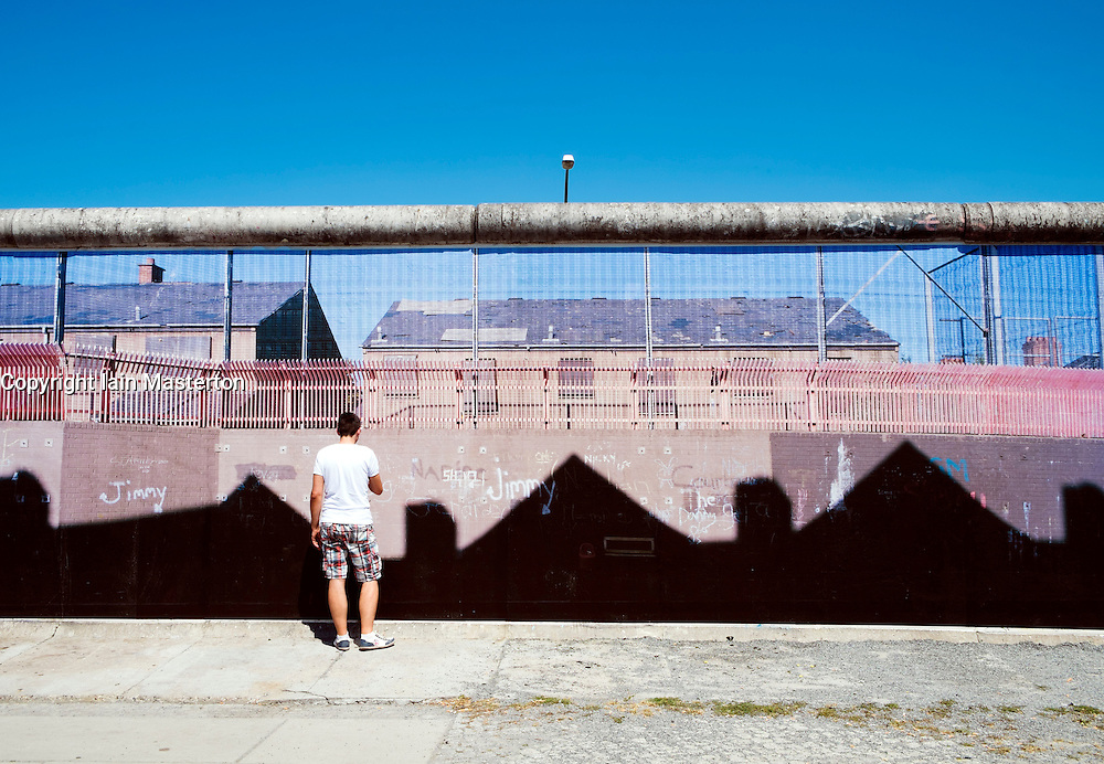 Photography exhibition by Kai Wiedenhofer entitled Wall on Wall displayed on Berlin Wall at East Side Gallery in Berlin Germany