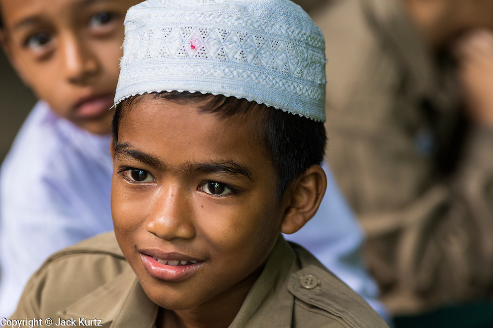 10 JULY 2013 - PATTANI, PATTANI, THAILAND: Boys at a private Muslim school in Pattani. Many Muslim parents prefer to send their children to Muslim private schools because they are safer (public schools have been attacked by Muslim insurgents), the Muslim schools teach an Islam centric curriculum and teach what many in Pattani consider a more accurate version of Pattani history.   PHOTO BY JACK KURTZ