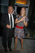 PETER MCKAY & ?, The Spectator At Home. Doughty St. 6 July 2006. ONE TIME USE ONLY - DO NOT ARCHIVE  © Copyright Photograph by Dafydd Jones 66 Stockwell Park Rd. London SW9 0DA Tel 020 7733 0108 www.dafjones.com