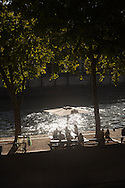 France. Paris. Seine river quays. Paris seine river quay . people gathering at sunset on right bank quays. Urban beach on the Seine river quays  Paris  France   / bain de soleil sur les quais de la seine