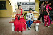 A mother and son dressed for a wedding wait on the platform.<br /> Outside the Dibrugarh-Kanyakumari Vivek Express, the longest train route in the Indian Subcontinent. It joins Kanyakumari, Tamil Nadu, which is the southernmost tip of mainland India to Dibrugarh in Assam province, near the border with Burma.