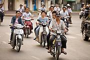 08 MARCH 2006 - Motorcycle riders drive around Saigon, Vietnam. Photo by Jack Kurtz / ZUMA Press