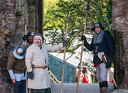 Medieval Day. Dirleton Castle, East Lothian, Scotland, United Kingdom, 11 May 2019. Pictured:  Historic Environment Scotland family fun day historical re-enactment of Medieval battles by Saltire History Society; 1298 English seizing the castle by Bishop Bek from John de Vaux and Robert the Bruce taking it from Aymer de Valence in early 1300s<br /> <br /> Sally Anderson   EdinburghElitemedia.co.uk